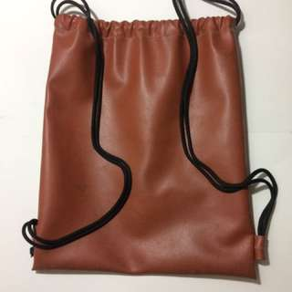 BROWN FAUX LEATHER DRAWSTRING