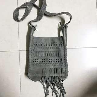 Grey tasseled handbag