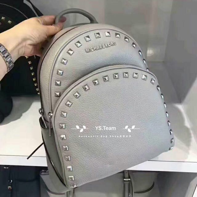 60ef9d39d982 Michael Kors Abbey Medium Frame Out Studded Leather Backpack on Carousell