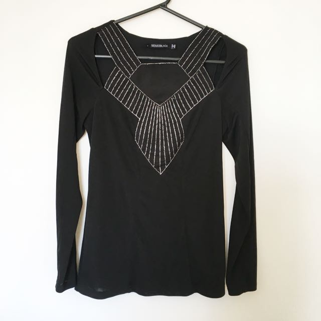 Seduce size 10 top with cut outs on the shoulder