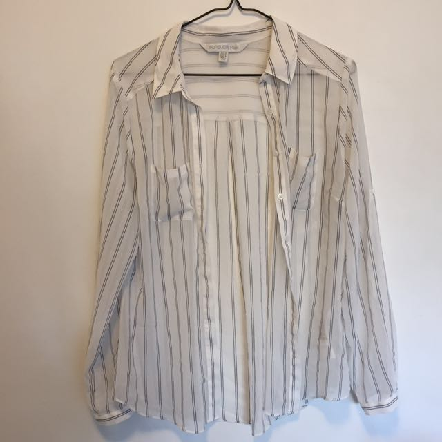 Sheer white shirt with black stripes