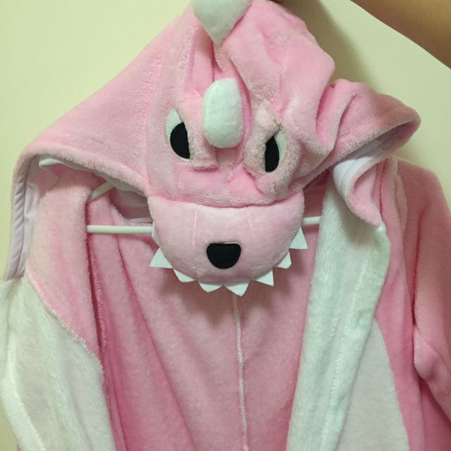Pink dinosaur onesie