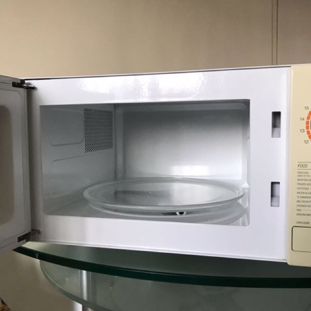 White In Colour Microwave Oven Home