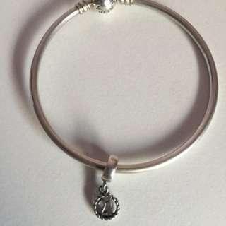 Genuine Pandora bangle with charm