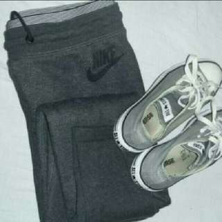 Nike shorts, trackpants and converse shoes