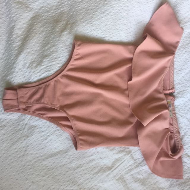 Pink body suit with frills