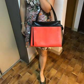 Celine snake orange and black handbag