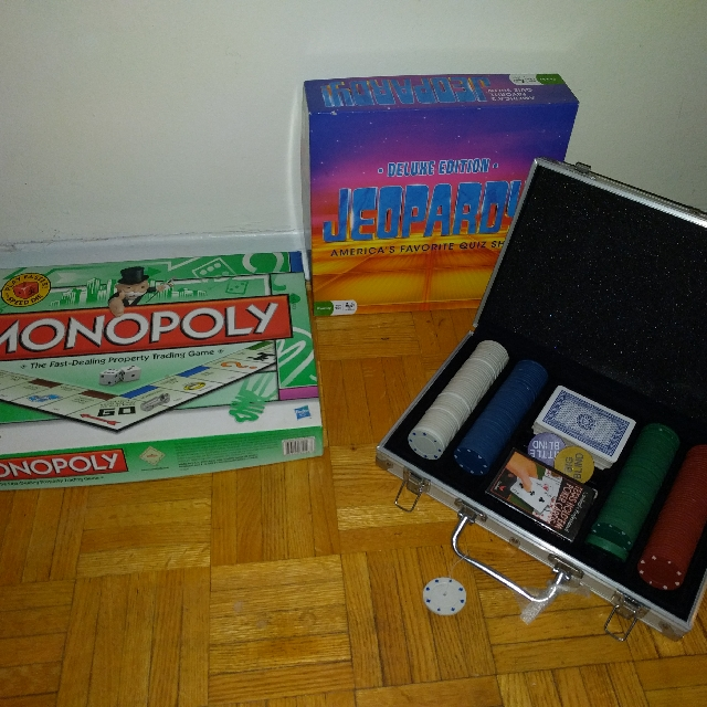 assorted games - monopoly, Jeopardy, poker set
