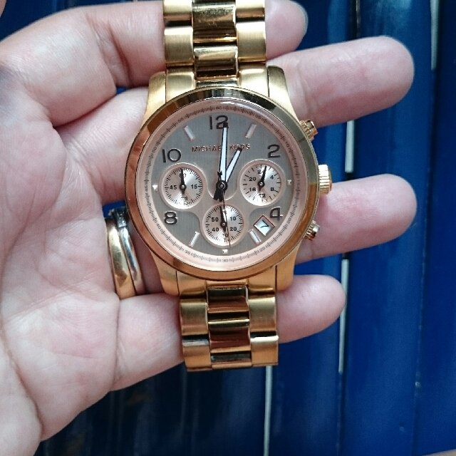 auth Michael Kors rose gold watch
