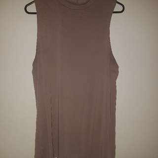 tan sleeveless shirt