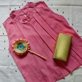 High neck sleeveless pink blouse