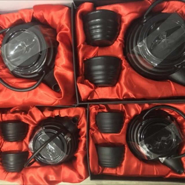 4 Cast iron tea sets