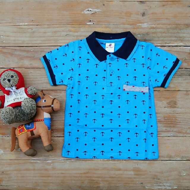 Light blue polo shirt with big dots and anchor print