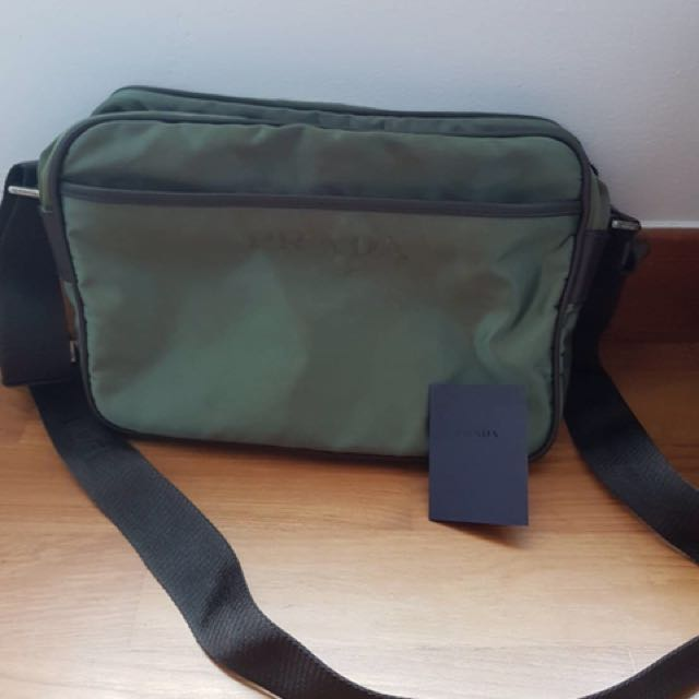 8417a5074e5f Prada navy green sling bag