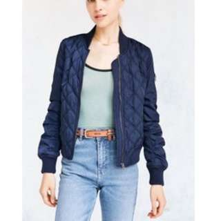 Navy blue quilted bomber