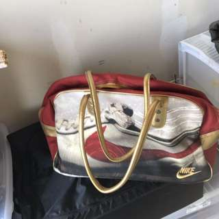 Brand New Nike gym or travel bag - red & gold
