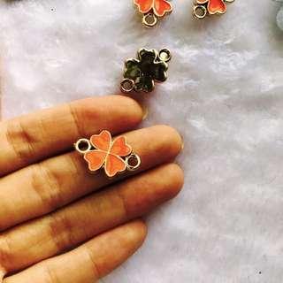 Orange four leaf clover charm pendant pack of 5