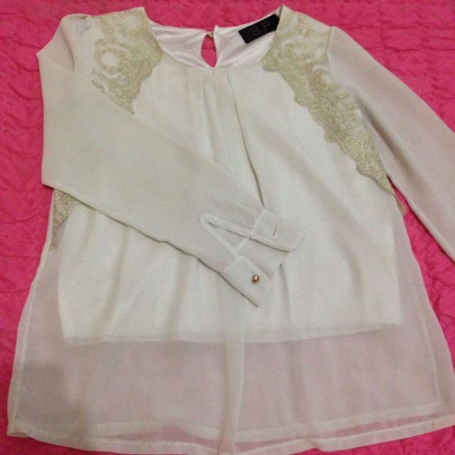 blouse atasan putih