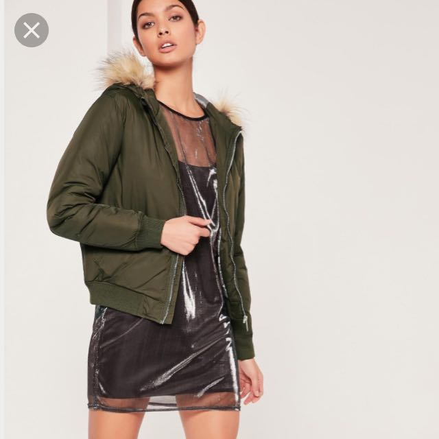 Green bomber jacket with hood and fur