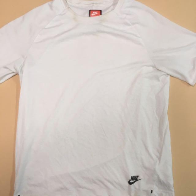 「寄賣」Nike 無肩線前短後長素T