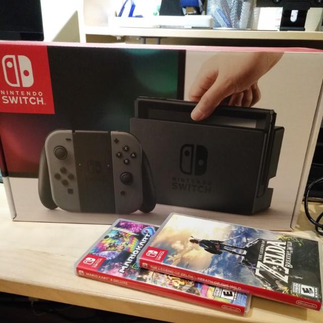 Nintendo Switch with Zelda and Mario Kart