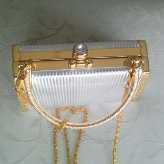 Silver and Gold clutch bag with crystal top clasp