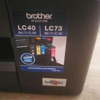 Almost new $100 4 colour inks plus printer