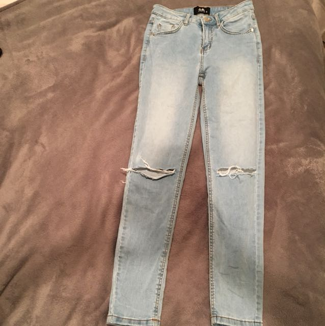 Blue knee ripped denim jeans