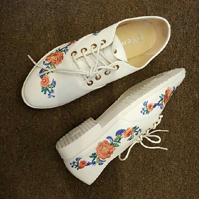 white shoes with floral details