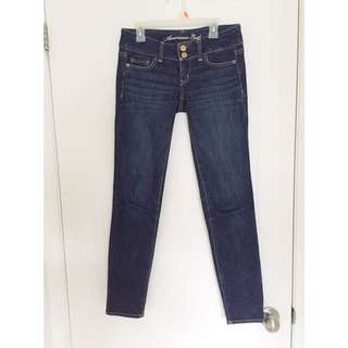 American eagle dark wash jeans with gold detailing