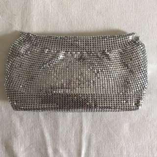 Silver mesh clutch