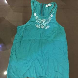 Folded and hung turquoise blue top