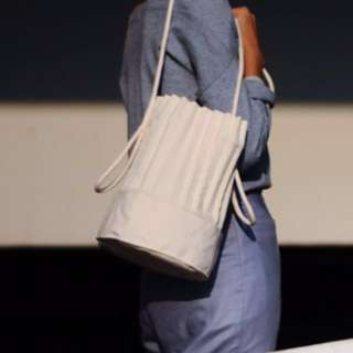 A pale petal white bucket bag