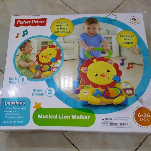 Fisher price musical lion walker, Bayi & Anak, Mainan & Baby Walker di Carousell