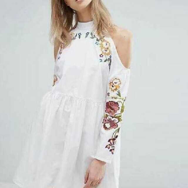 white dress with floral details