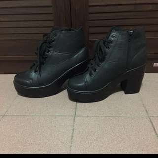 Black bulky heeled boots