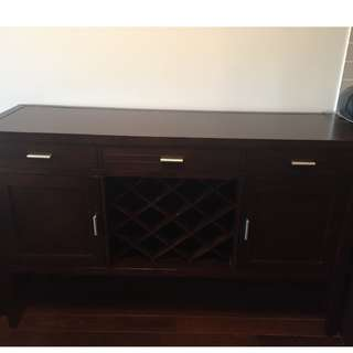Buffet table with wine rack