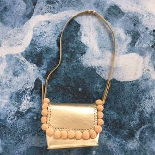 Charles & Keith metallic gold small handbag / purse with nude pom-poms