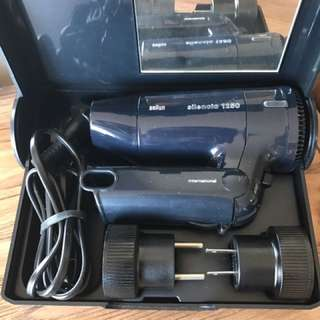 Portable hair dryer with adaptor in case