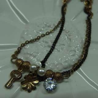 double strand copper tone charm bracelet