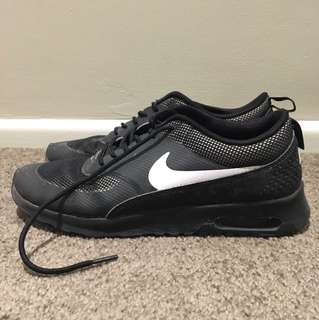 Black and White Nike Theas
