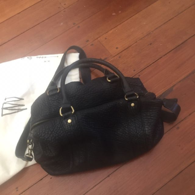Status anxiety leather bag
