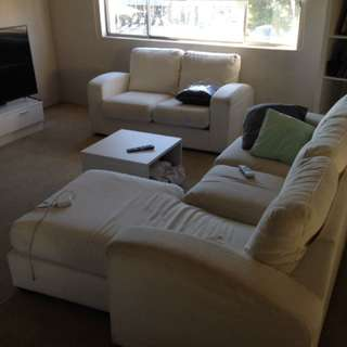 2 white comfortable Lounges