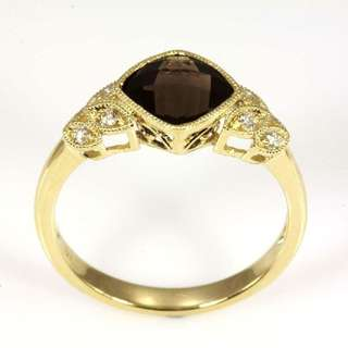 Quartz and Diamond 9ct. gold ring with a cushion checkerboard cut Smokey Quartz