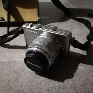 Olympus EPL-3 + 18-42mm Lens