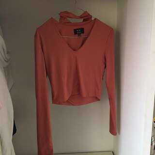 Cropped long sleeve pink top