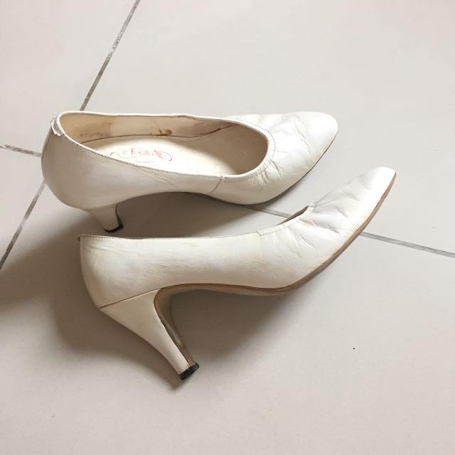Broken white shoes