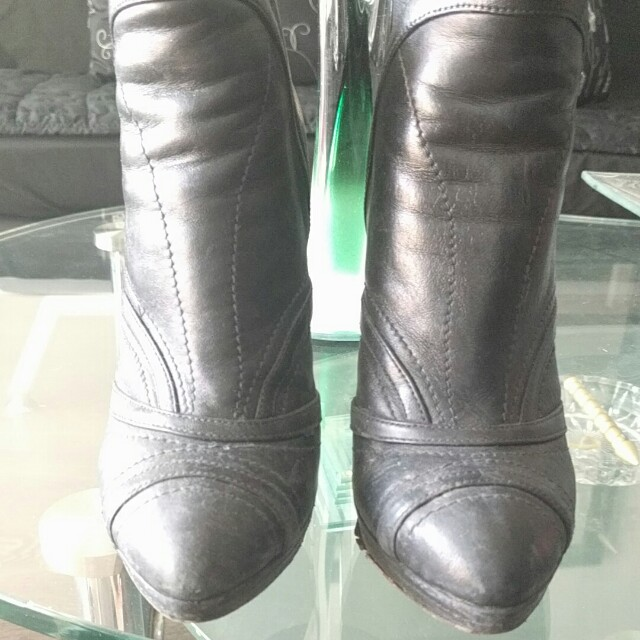 Leather Prada booties size 35.5 5.5