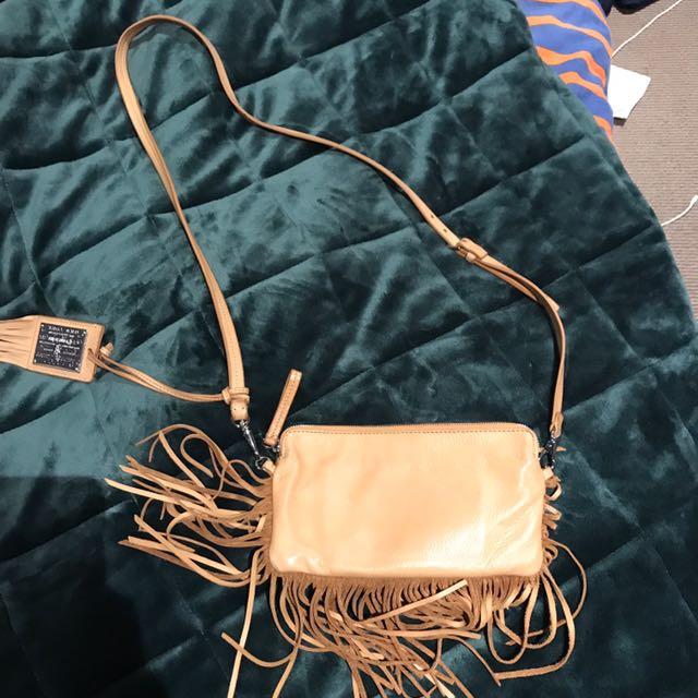 Ralph Lauren tassel clutch with strap