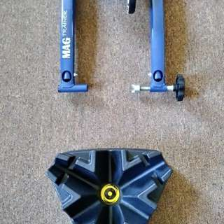 MAG folding indoor bicycle trainer + Cycleops climbing riser block